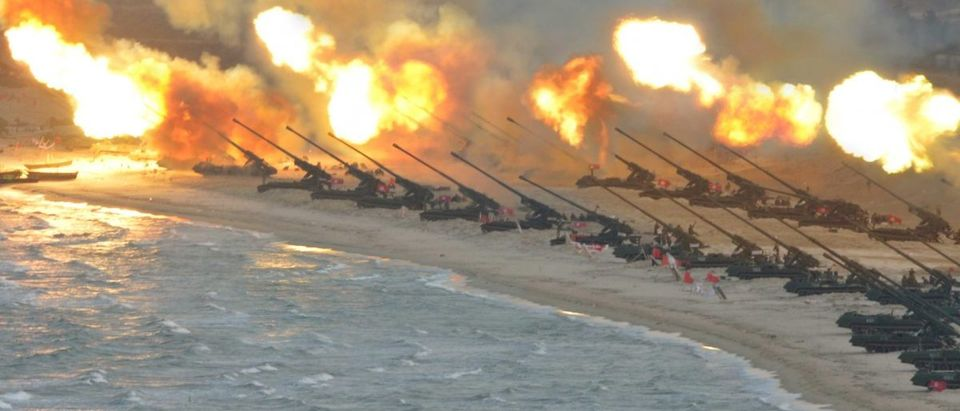Artillery pieces are seen being fired during a military drill at an unknown location, in this undated photo released by North Korea's Korean Central News Agency (KCNA)