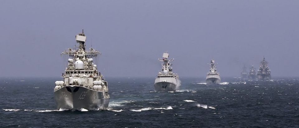 Chinese and Russian naval vessels participate in the Joint Sea-2014 naval drill outside Shanghai on the East China Sea