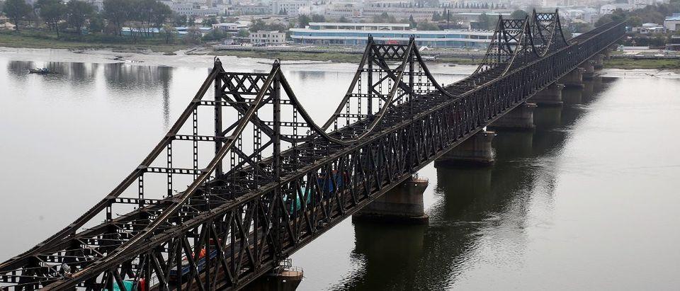 Trucks cross Friendship Bridge from China's Dandong, Liaoning province, to North Korea's Sinuiju