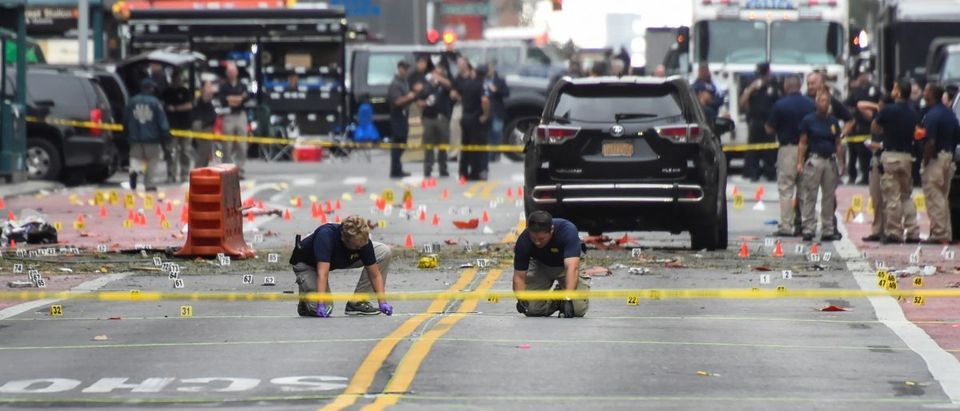 FBI officials mark ground near site of explosion in New York