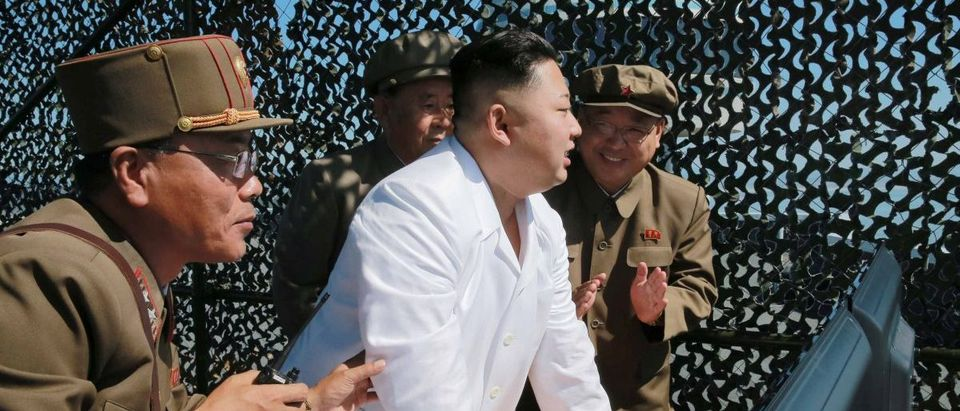 North Korean leader Kim Jung Un supervises a demonstration of a new rocket engine for the geo-stationary satellite at the Sohae Space Center n this undated photo released by North Korea's Korean Central News Agency (KCNA) in Pyongyang
