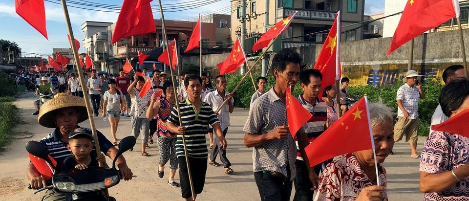 Villagers carrying Chinese national flags protest at Wukan village in China's Guangdong province