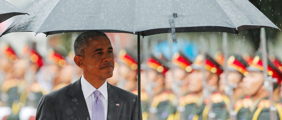 U.S. President Barack Obama reviews honour guard during a welcoming ceremony at the Presidential Palace in Vientiane