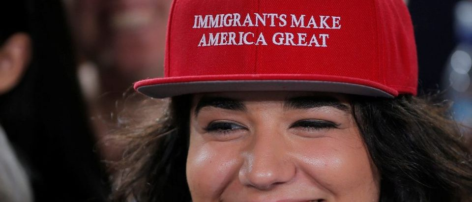 "Audience member Ana Gomez wears a cap reading ""Immigrants Make America Great"" at a campaign Voter Registration Rally with U.S. Democratic presidential nominee Hillary Clinton"