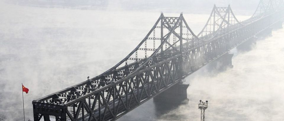 The Friendship Bridge, which connects the Chinese city of Dandong with Sinuiju in North Korea, is seen amid heavy fog over the Yalu River, in Dandong