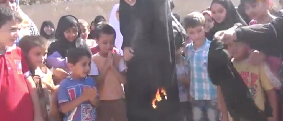 Daily Mail Video screen shot of Syrian women burning a burka