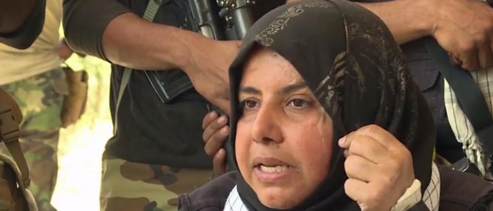 Um Hanadi shows scars from battling ISIS. (screenshot from CNN video)