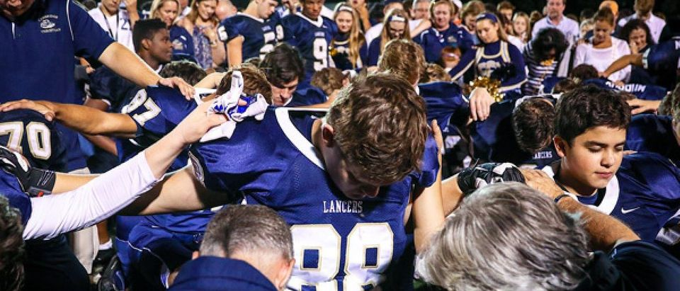 Cambridge Christian School students praying at high school football game, per their tradition (Photo credit: Beth Dare Photography, courtesy of Liberty Institute)