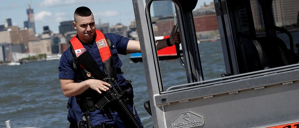 A U.S. Coast Guard officer rides a patrol boat in New York Harbor during the America's Cup World Series sailing event in New York, U.S., May 8, 2016. REUTERS/Mike Segar