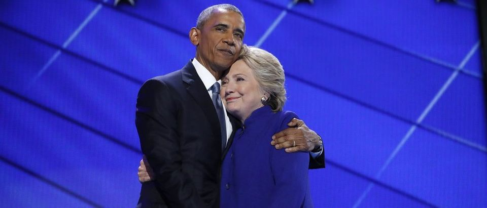 Democratic presidential nominee Hillary Clinton is embraced by U.S. President Barack Obama as she arrives onstage at the end of his speech on the third night of the 2016 Democratic National Convention in Philadelphia, Pennsylvania