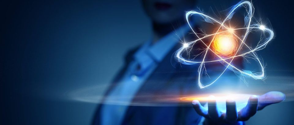 Atom molecule in female hand (Shutterstock/ Sergey Nivens)