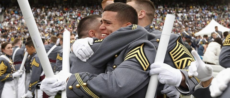Members of graduating class embrace at the end of the commencement ceremony at the United States Military Academy at West Point