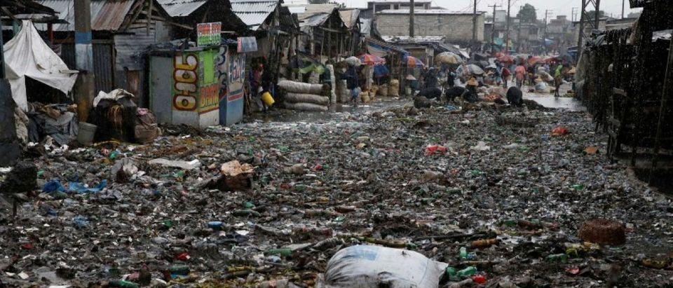 People wade across a flooded street while Hurricane Matthew passes through Port-au-Prince, Haiti