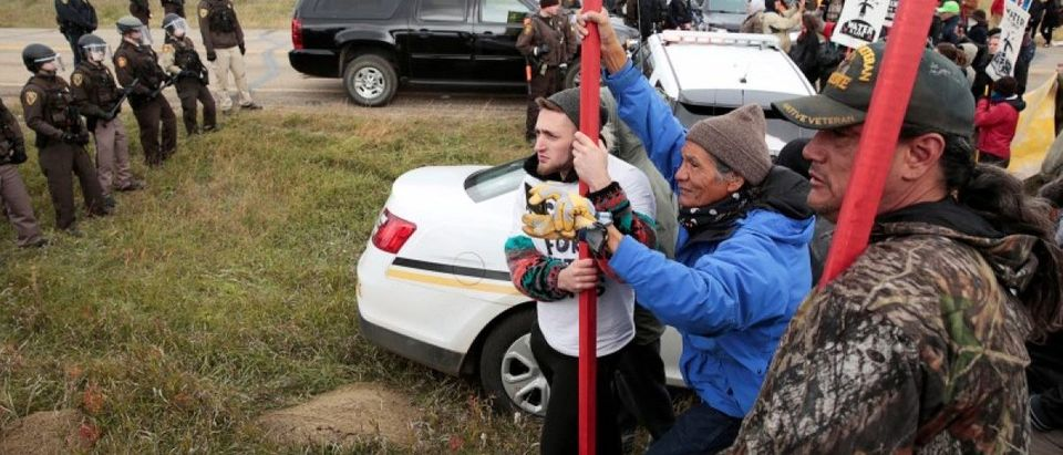 Dakota Access Pipeline protesters square off against police between the Standing Rock Reservation and the pipeline route outside the little town of Saint Anthony