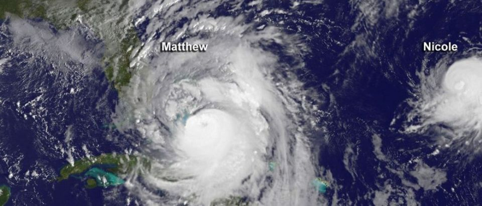 Hurricane Matthew is seen to the west of a much smaller Hurricane Nicole in this image from NOAA's GOES-East satellite