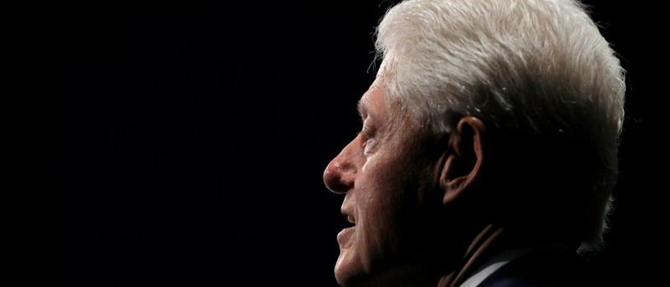 Former U.S. President Bill Clinton waits for the presidential town hall debate between U.S. Democratic presidential nominee Hillary Clinton and U.S. Republican presidential nominee Donald Trump at Washington University in St. Louis