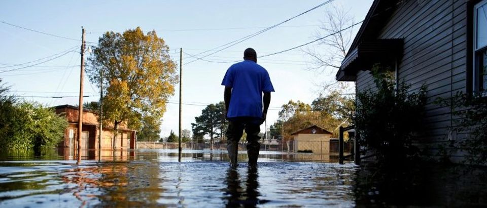 Eric McClary of West Mulberry Lane checks flood levels while checking on his flooded home after the effects of Hurricane Matthew in Goldsboro