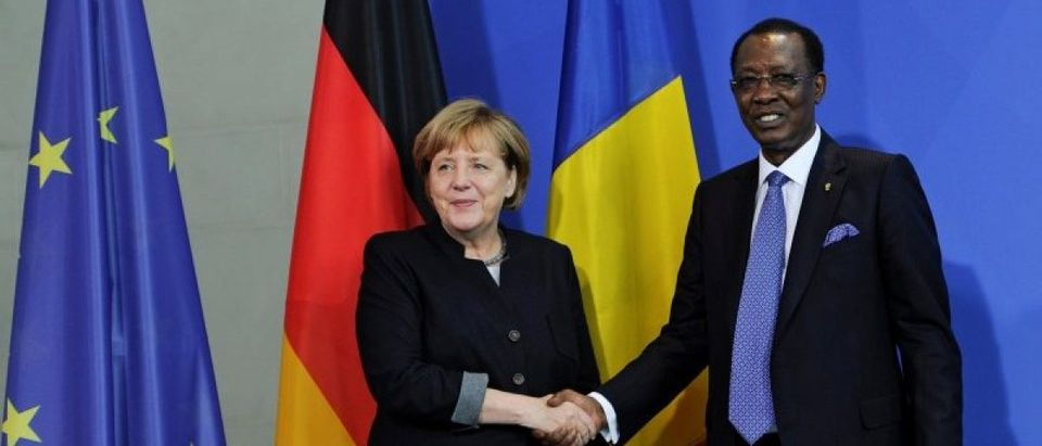 German Chancellor Merkel and Chad President Deby shake hands after a news conference at the Chancellery in Berlin