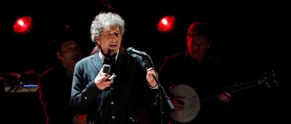 Singer Bob Dylan performs during a segment honoring Director Martin Scorsese, recipient of the Music+ Film Award, at the 17th Annual Critics' Choice Movie Awards in Los Angeles January 12, 2012. REUTERS/Mario Anzuoni/File Photo