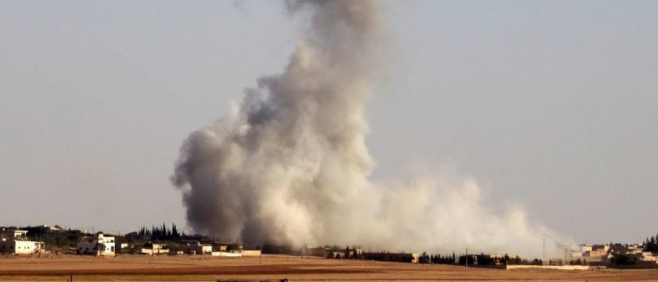 Smoke rises from airstrikes on Guzhe village, northern Aleppo countryside