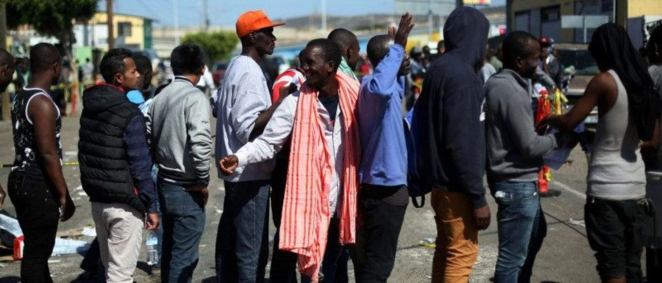 Haitian migrants line up outside Padre Chava shelter after leaving Brazil, where they sought refuge after Haiti's 2010 earthquake, but are now attempting to enter the U.S., in Tijuana