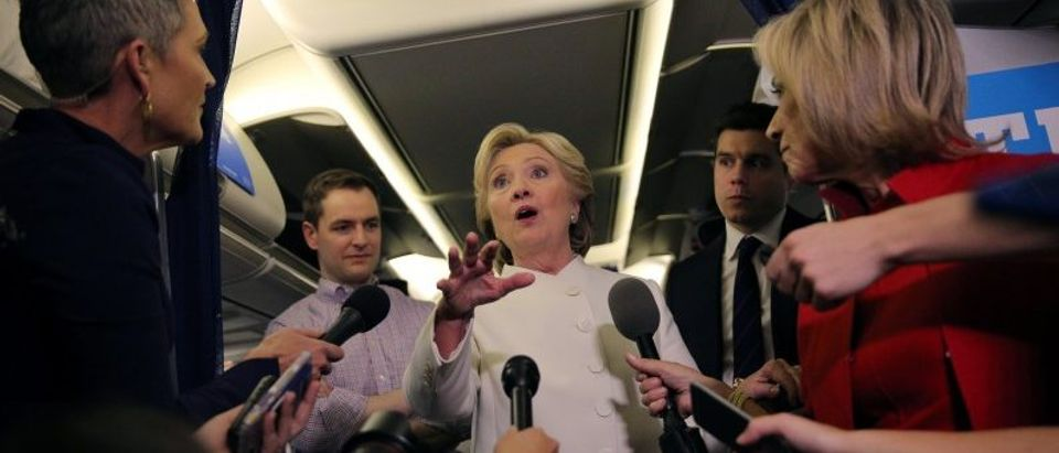 Democratic U.S. presidential candidate Hillary Clinton talks to the media inside of her campaign plane after the third and final 2016 presidential campaign debate in North Las Vegas