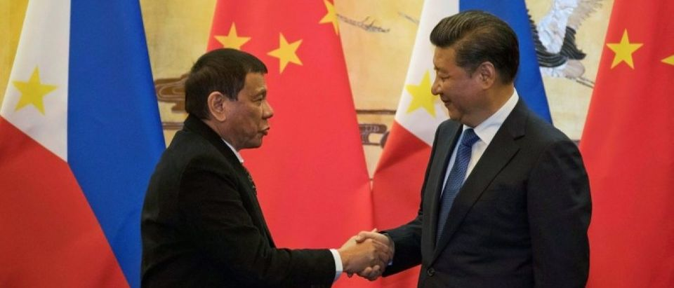 Philippines President Rodrigo Duterte and Chinese President Xi Jinping shake hands after a signing ceremony held in Beijing