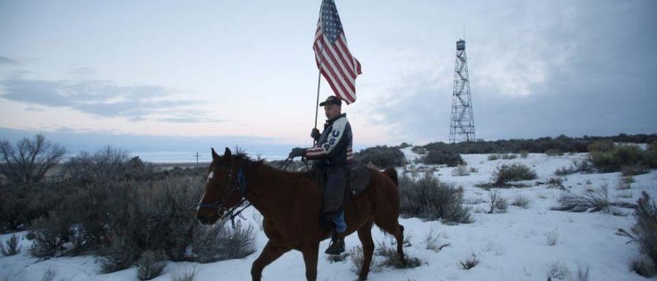 Occupier Duane Ehmer rides his horse Hellboy at Malheur National Wildlife Refuge near Burns, Oregon