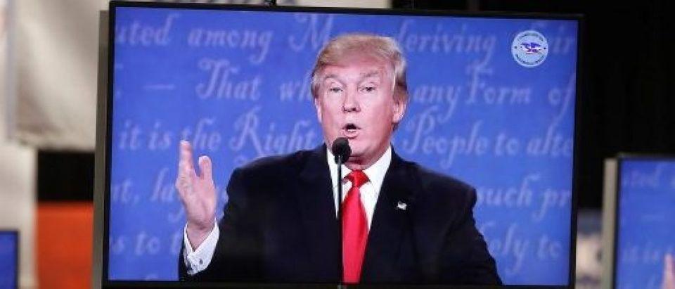 Republican U.S presidential nominee Donald Trump is shown on TV monitors in the media filing room during the last 2016 U.S. presidential debate in Las Vegas
