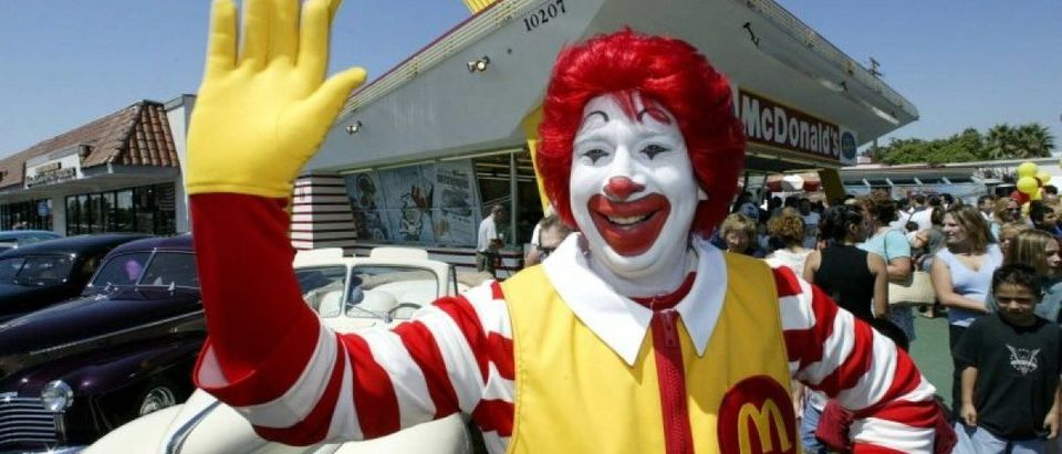 File photo of a Ronald McDonald character posing at the world's oldest operating McDonald's restaurant, with the or..