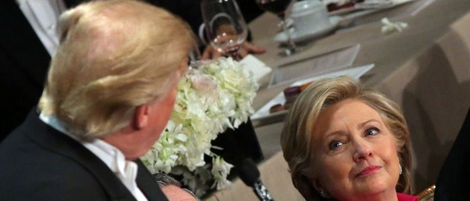 Hillary Clinton looks at Donald Trump as he speaks. REUTERS/Carlos Barria