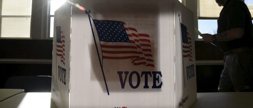 File photo of a voter heading to the booth to fill out his ballot at a polling site in Stillwater
