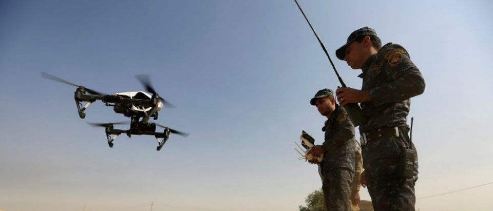 Member of Iraqi forces operates an unmanned drone to make it fly over Islamic State position outside the town of Safayah near Mosul