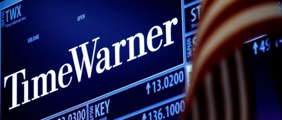 Ticker and trading information for media conglomerate Time Warner Inc. is displayed at the post where it is traded on the floor of the New York Stock Exchange in New York City