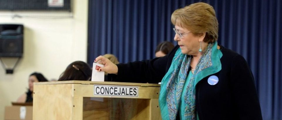 Chile's President Michelle Bachelet casts her ballot during the mayors and councillors elections in Santiago