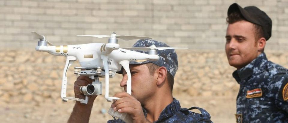 A federal police forces member uses a drone during an operation against Islamic State militants in Qayyara, south of Mosul