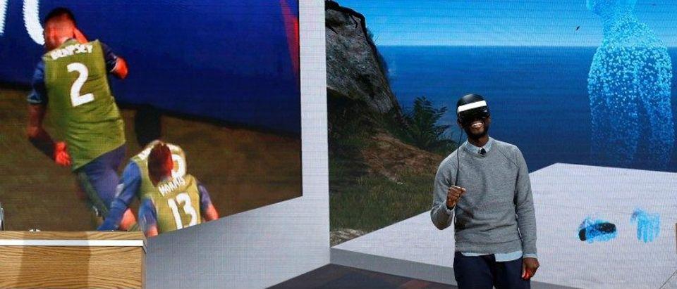 "Taj Reid, Senior Designer at Microsoft wears a HoloLens VR headset at Microsoft's Windows 10 ""Creators Update"" live event in New York"