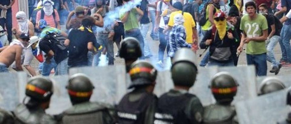Demonstrators clash with members of Venezuelan National Guard during a rally demanding a referendum to remove Venezuela's President Nicolas Maduro