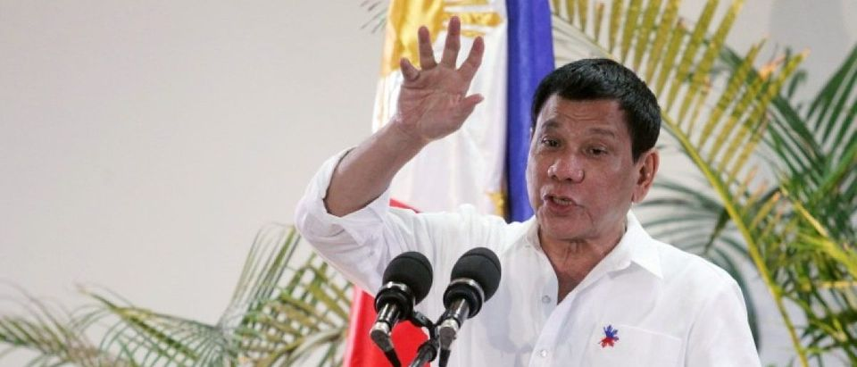 Philippine President Rodrigo Duterte gestures while answering questions during a news conference in Davao city