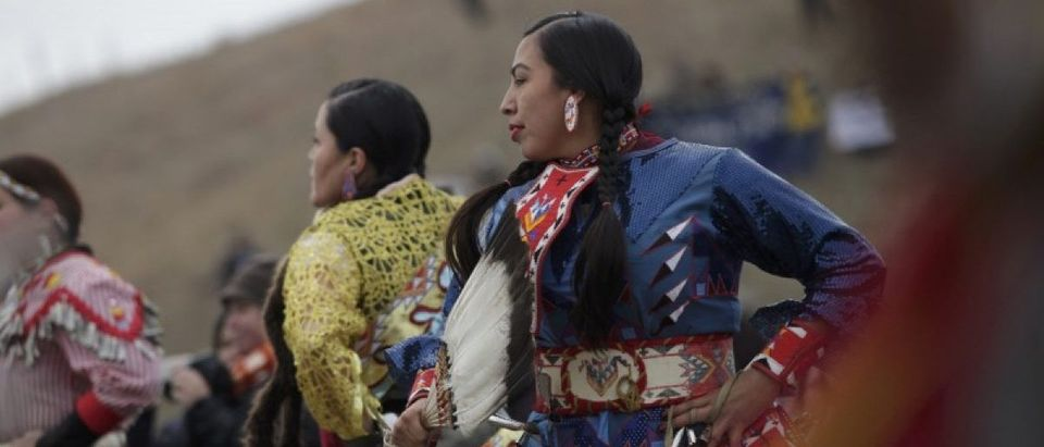 Native American dancers perform during a peaceful demonstration near the Dakota Access Pipeline construction site north of Cannon Ball, North Dakota