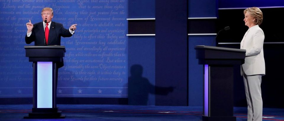 Republican presidential nominee Donald Trump speaks as Democratic nominee Hillary Clinton listen during their third and final 2016 presidential campaign debate at UNLV in Las Vegas, Nevada, October 19, 2016
