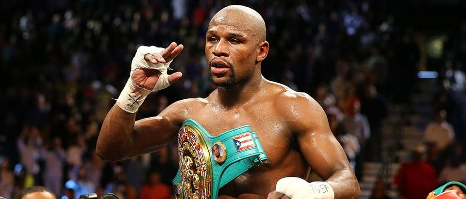 Floyd Mayweather Jr. celebrates his unanimous-decision victory over Robert Guerrero in their WBC welterweight title bout at the MGM Grand Garden Arena on May 4, 2013 in Las Vegas, Nevada