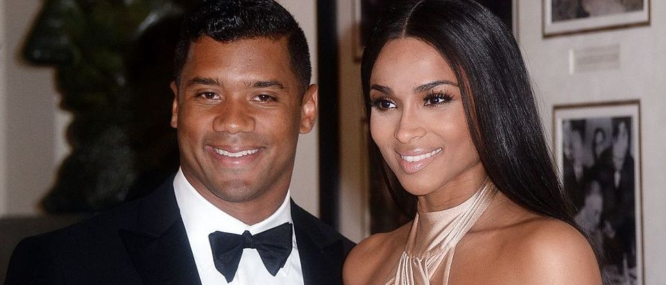 Russell Wilson from the Seattle Seahawks and Ciara Harris arrive for the State dinner in honor of Japanese Prime Minister Shinzo Abe And Akie Abe April 28, 2015 at the Booksellers area of the White House in Washington, D.C.