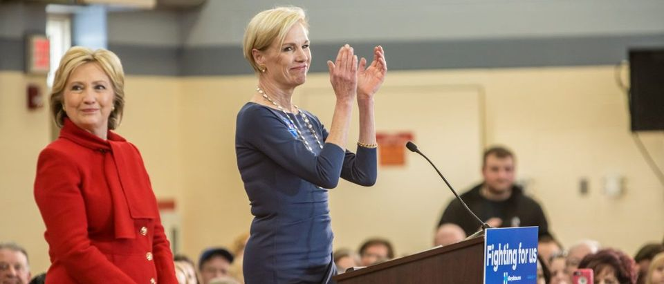 Cecile Richards (R) introduces Democratic presidential candidate Hillary Clinton at a campaign event with (2nd R), president of Planned Parenthood, at Buford Garner Elementary School on January 24, 2016 in North Liberty, Iowa. (Brendan Hoffman/Getty Images)