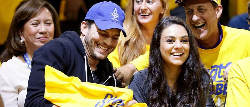 Ashton Kutcher and Mila Kunis attend Game 2 of the 2016 NBA Finals (Getty Images)