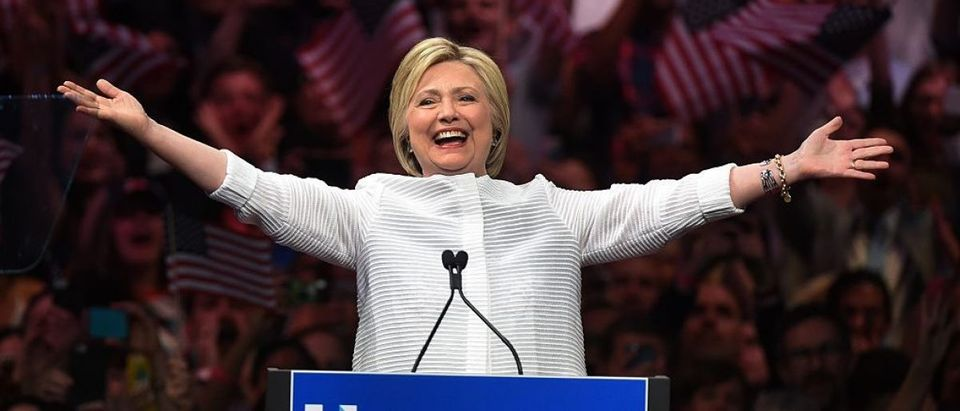 Hillary Clinton acknowledges celebratory cheers from the crowd during her primary night event at the Duggal Greenhouse on June 7, 2016 in New York (Getty Images)