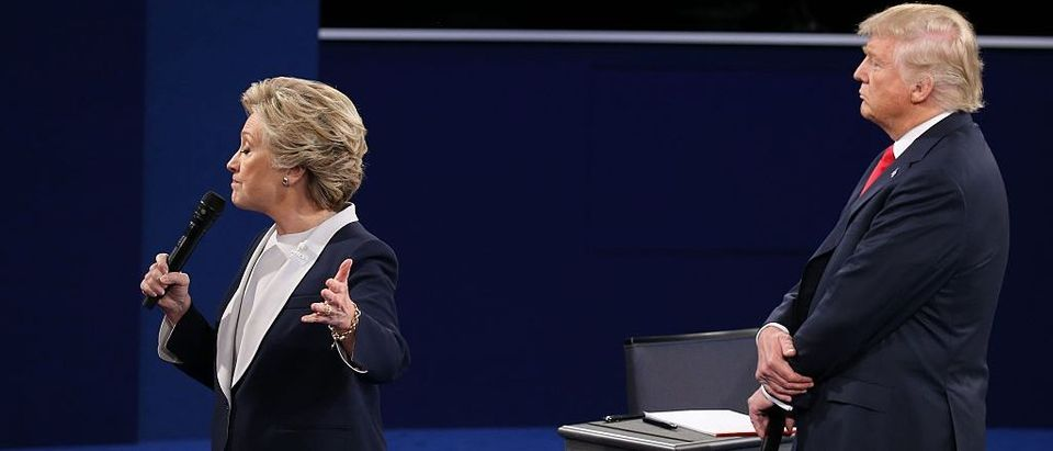 US Democratic presidential candidate Hillary Clinton and US Republican presidential candidate Donald Trump debate during the second presidential debate at Washington University in St. Louis, Missouri, on October 9, 2016. (TASOS KATOPODIS/AFP/Getty Images)