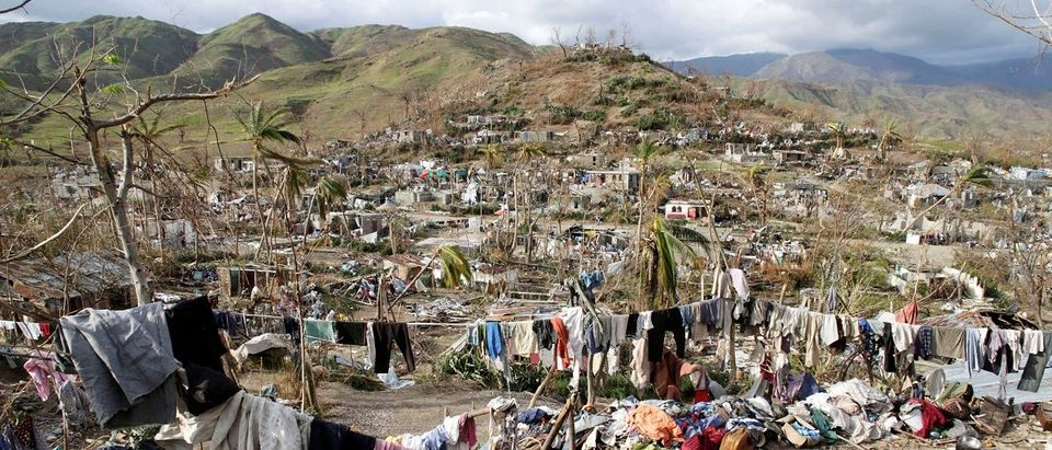 Clothes hang in an area destroyed by Hurricane Matthew in Les Anglais, Haiti