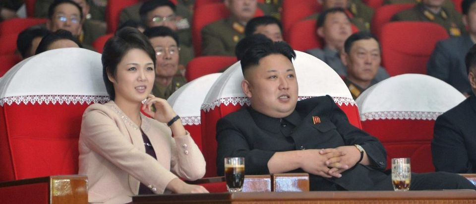 North Korean leader Kim Jong Un and his wife Ri Sol Ju watch a performance by the Moranbong Band at the April 25 House of Culture in this undated photo released by North Korea's Korean Central News Agency (KCNA) in Pyongyang on March 24, 2014. REUTERS/KCNA