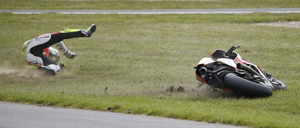 Pramac Racing MotoGP rider Andrea Iannone of Italy crashes out of the Australian Grand Prix on Phillip Island
